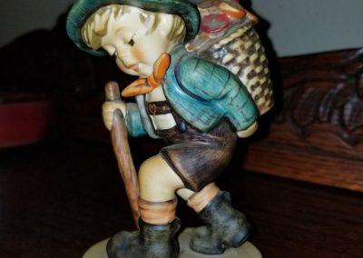 Hummel Goebel 381 - Flower Vendor Boy carrying a flower basket